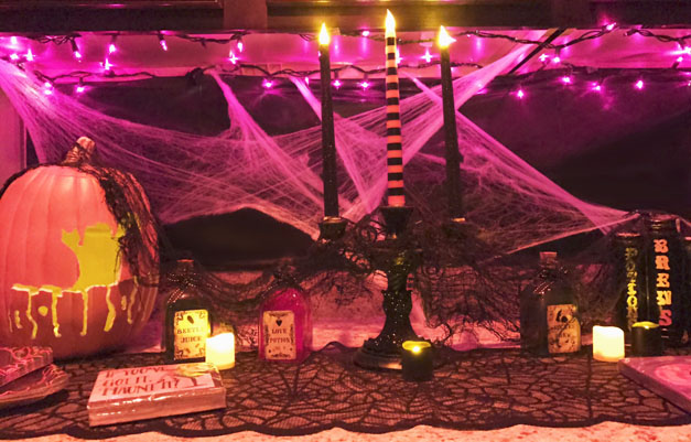 Some witchy touches, set off with LED candles...