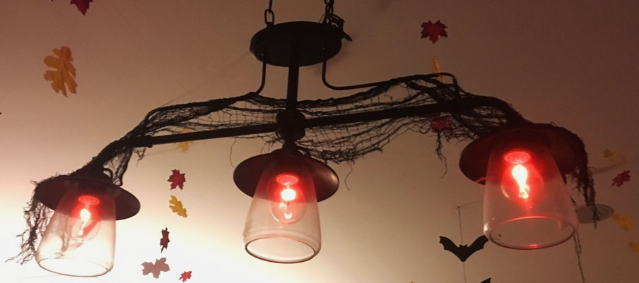We hung fall-colored leaves and bats from the ceiling. Flickering lights made for extra spooky ambience.